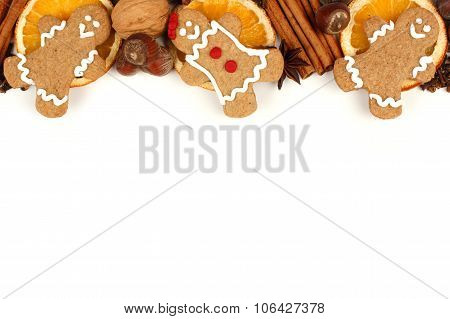 Christmas gingerbread men border with holiday spices over white