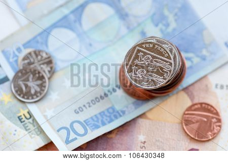 Ten British Pence Coin And Euro Note