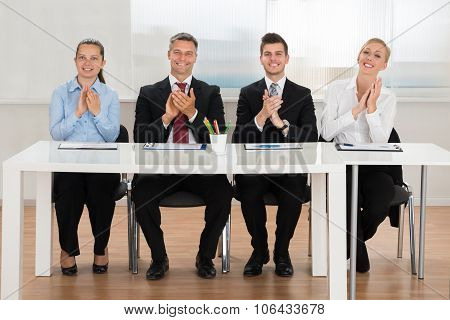 Businesspeople Applauding In Conference