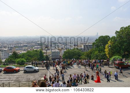 PARIS, FRANCE - AUGUST 10, 2015: Paris cityscape from the Sacre-Cceur Basilica. The Basilica is a Roman Catholic church and minor basilica, dedicated to the Sacred Heart of Jesus, in Paris, France.