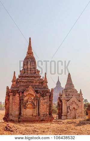 Bagan, red and white pagoda in the field