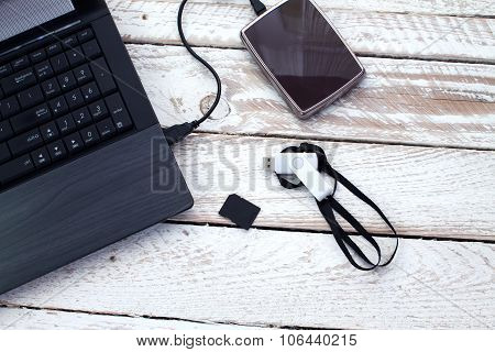 Laptop with pendrive, SD card and portable hard drive.
