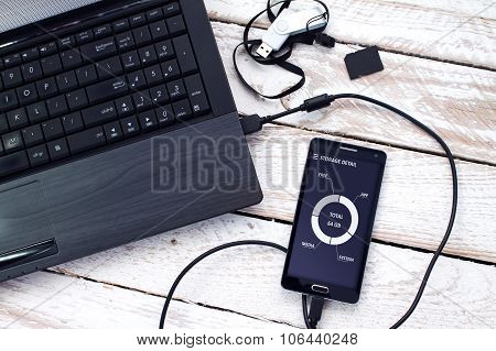 Laptop with pendrive, SD Card and smartphone.