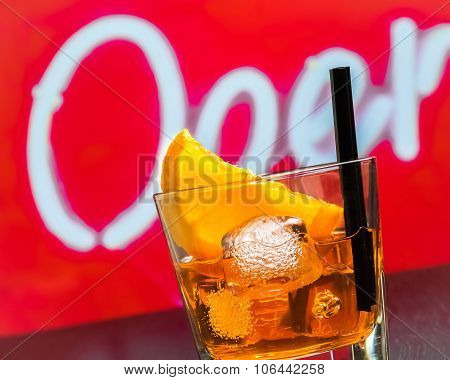 Detail Of Glass Of Spritz Aperitif Aperol Cocktail With Orange Slices And Ice Cubes On Bar Table, Di