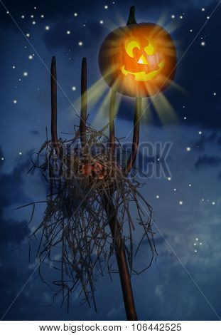 Pumpkin sitting on a pitchfork loaded with hay