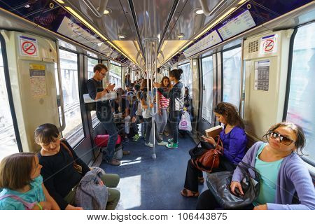PARIS - SEPTEMBER 10, 2014: passengers in Paris Metropolitain train. The Paris Metro or Metropolitain is a rapid transit system in the Paris Metropolitan Area