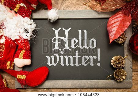 Blackboard with the text: Hello Winter in a christmas conceptual image