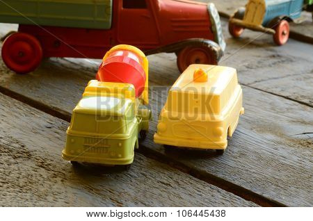 Set of vintage toys - ambulance toy car and concrete mixer toy.
