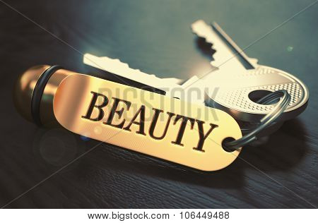 Beauty - Bunch of Keys with Text on Golden Keychain.