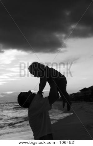 Father And Daughter Play On The Beach