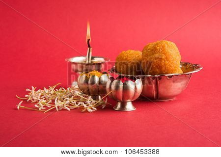 Beautifully Decorated Pooja Thali for diwali celebration to worship , having Indian sweet motichoor