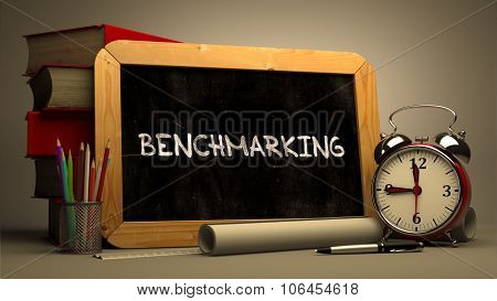 Hand Drawn Benchmarking Concept on Chalkboard.