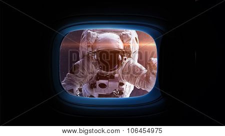 Beautiful cosmos in space ship window porthole. Elements of this image furnished by NASA.