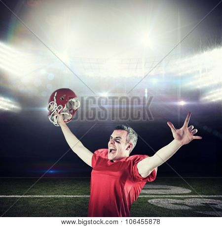 A triumph of an american football player without his helmet against american football arena