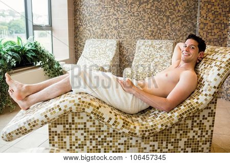 Handsome man relaxing in thermal suite at the spa