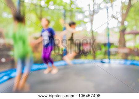 Blur Image Of Kid Jumping In Trampoline On Day Time