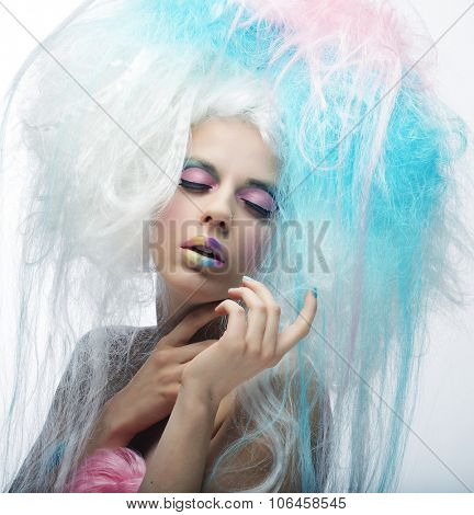 Young fashion model with bright make up and colorful hair