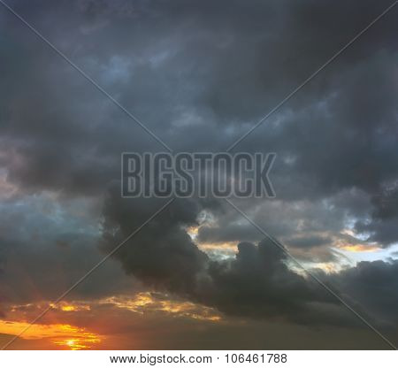 Sunset In Stormy Gray Clouds