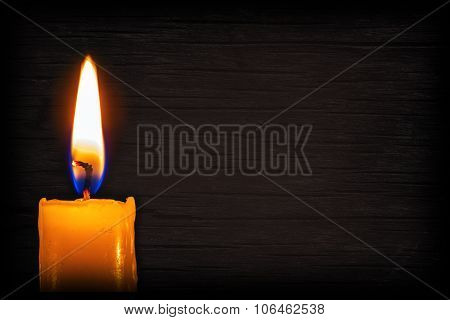 Candle On A Background With A Wooden Texture. Wood Background For Text