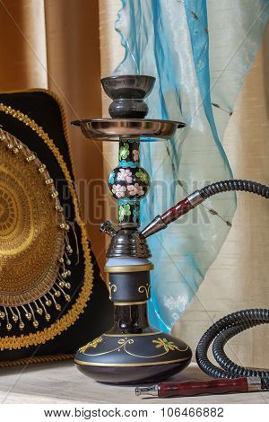 Beautiful hookah standing on a table in the eastern interior