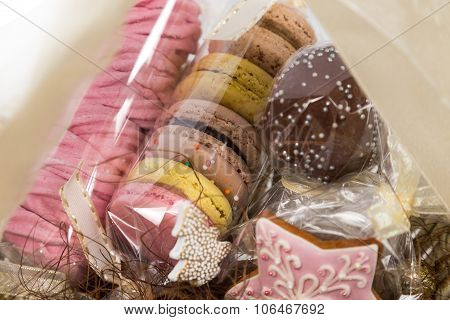 Sweet Christmas Present In Basket With Pastry