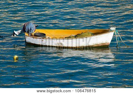 Small wooden boat at the beach of La Caleta, Cadiz, Andalucia, Spain