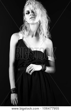 Daring Girl Model In Black Silk Dress, Style Of Rock, Dark Make-up, Wet Hair And Bracelets On Her Ar