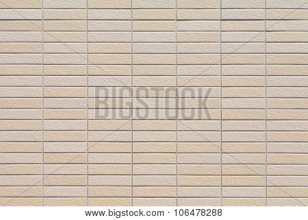 The modern brown concrete tile wall background and texture