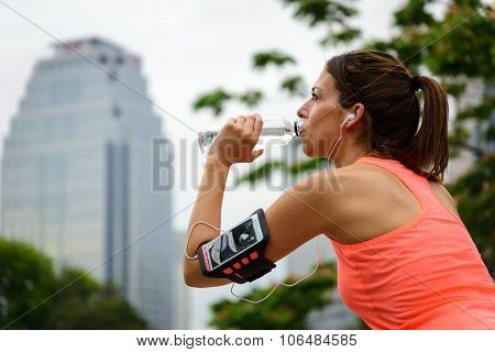Fitness Female Runner Driking Water On Workout Rest