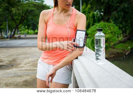 Fitness Woman With Smartphone Armband Ready For Running