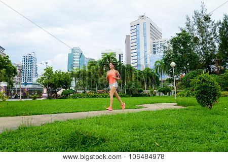 Fitness Woman Running At City Park In Bangkok