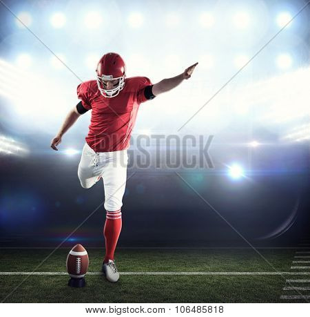 American football player kicking football against american football arena