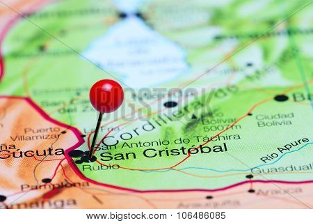 San Cristobal pinned on a map of America
