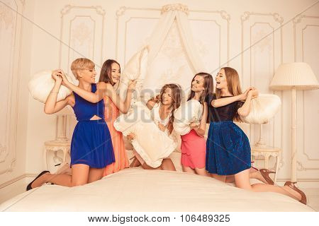 Pretty Girls Celebrating A Bride's Bachelorette Party And Fighting With Pillows