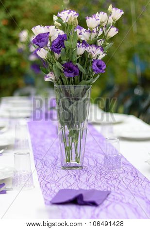 Outdoors Table Set Up For A Party In Purple And White