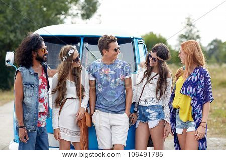 summer holidays, road trip, vacation, travel and people concept - smiling young hippie friends over minivan car
