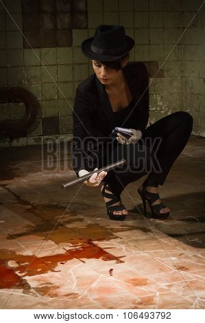 Criminalist Investigating The Crime Scene