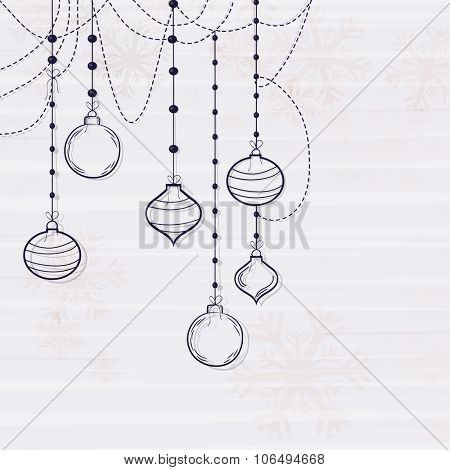 Greeting card design with creative Xmas Balls on Snowflakes decorated background for Merry Christmas celebration.
