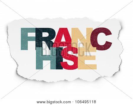 Finance concept: Franchise on Torn Paper background