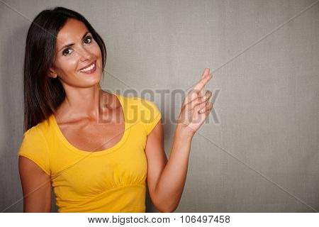 Charismatic Woman Crossing Fingers While Smiling