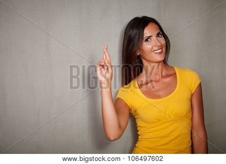 Confident Youngster Crossing Fingers While Smiling
