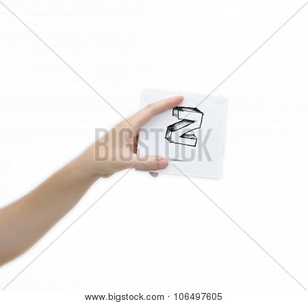 Hand Holding A Piece Of Paper With Sketchy Capital Letter Z, Isolated On White.