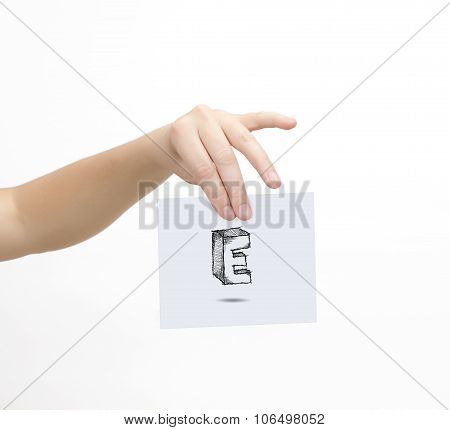 Hand Holding A Piece Of Paper With Sketchy Capital Letter E, Isolated On White.