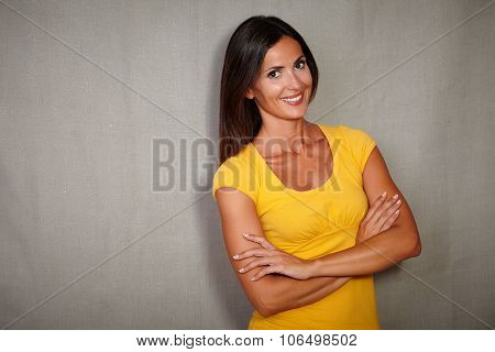Charismatic Woman Standing With Arms Crossed