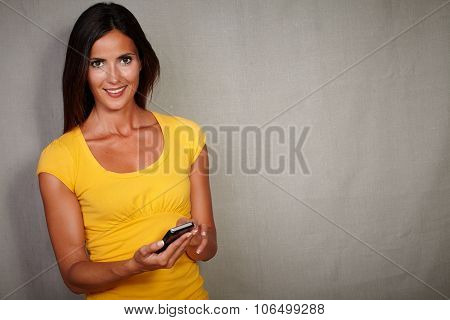 Happy Young Female Holding Mobile Phone