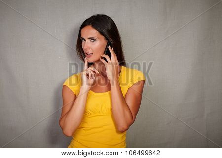 Young Woman Planning While Speaking On Cell Phone