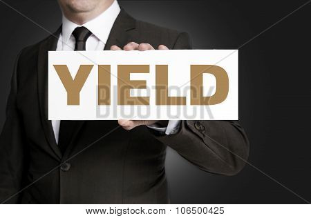 Yield Sign Held By Businessman Concept