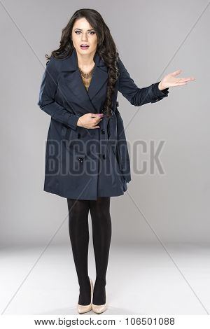 Business Woman Shrugging With I Don't Know Gesture, Isolated On Gray Background