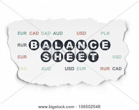 Banking concept: Balance Sheet on Torn Paper background