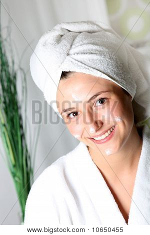 Smiling Young Woman With Cream On Her Face Relaxed.